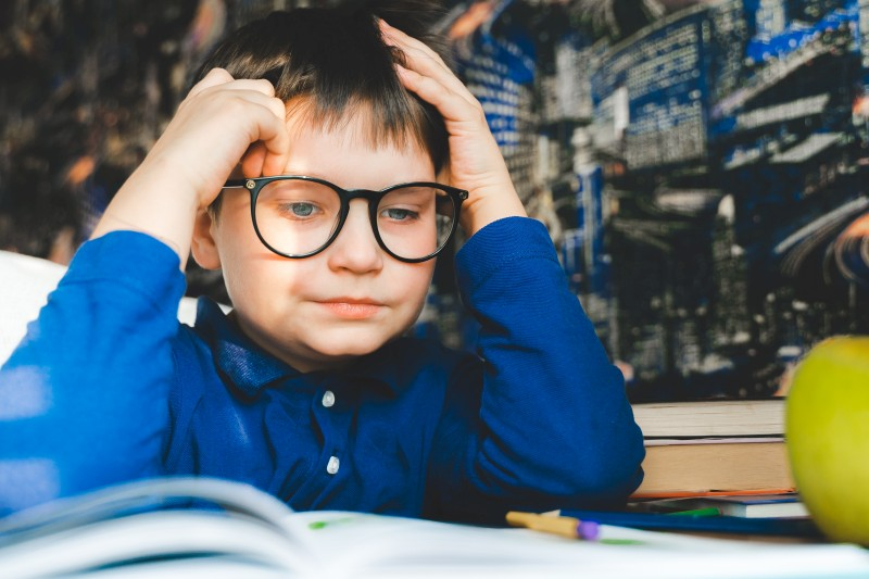 Cute kid studying book