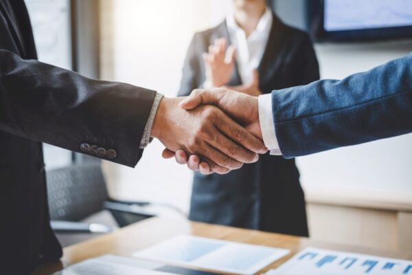 Handshake after meeting discussion trading business